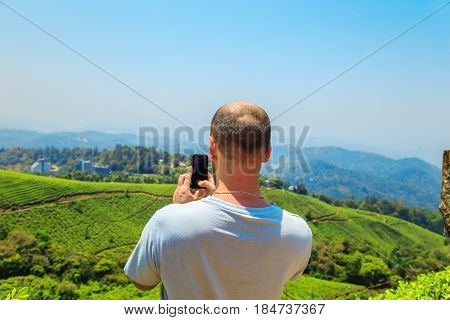 Man Inspects The Mountain Landscape.