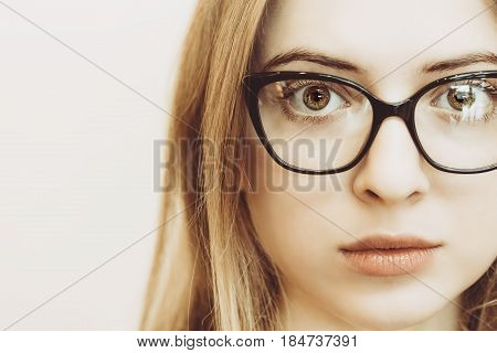 Closeup Of And Eye Of Blonde Woman With Black Glasses
