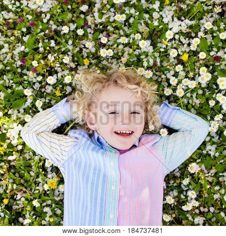 Child On Green Grass Lawn With Summer Flowers