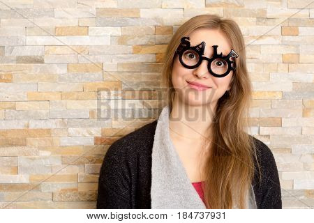 Smiling Woman With Glasses Shaped Into Sale Text