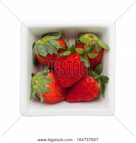 Strawberries in a square bowl isolated on white background