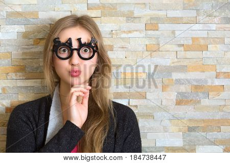 Surprised Woman With Glasses Shaped Into Sale Text