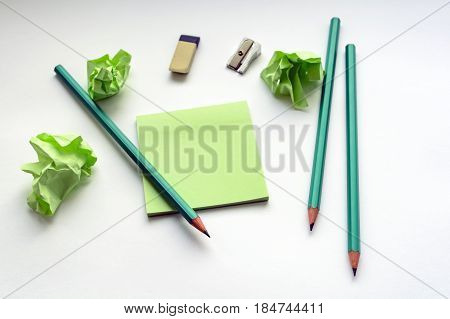 Pencils, Sharpener, Eraser, Stickers, On A White Table With Crumpled Sticky Notes, Creative Crisis,