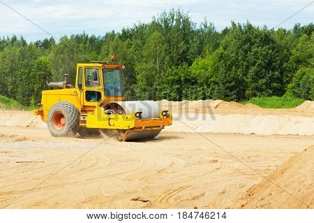 Roller preparing ground for building a new road