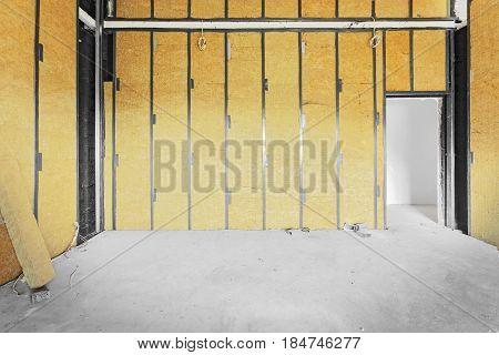 Unfinished building interior walls covered with rock-wool.
