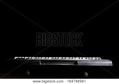 Synthesizer Keyboard In The Dark Background With Copy Space