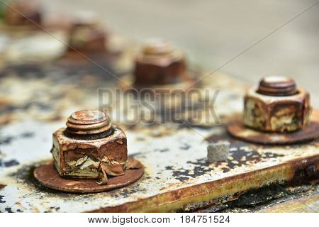 Soft focus of Corrosive rusted bolt with nut.Rusty Old Industrial Screw Nut and Bolt