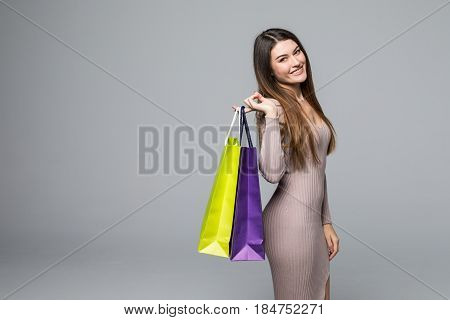 Woman With Many Shopping Bags On Gray Background