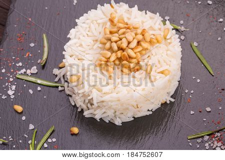 Rees spicy with pine nuts and greens, is served to meat dishes