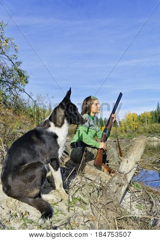 The girl-hunter with a dog in an ambushSiberia