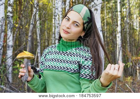 The girl with a mushroom found in the forest