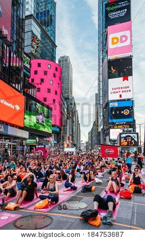 NEW YORK CITY -JUNE 21: People in the yoga annual concentration on the summer solstice in Times Square, iconic symbol of New York City and the United States of America, March 21, 2016 in Manhattan, New York City, USA.