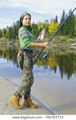 Beautiful girl on a fishing trip in the taiga Siberia