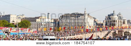 Moscow, Russia - May 9, 2016: Immortal Regiment procession in Victory Day - thousands of people marching in commemoration of their loved ones who fought in World War Two