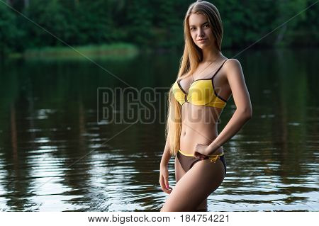 elegant girl teenager in fashionable swimsuit outdoors
