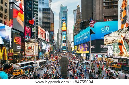 NEW YORK CITY -JUNE 21: People and famous led advertising panels in Times Square, iconic symbol of New York City and the United States of America, March 21, 2016 in Manhattan, New York City, USA.