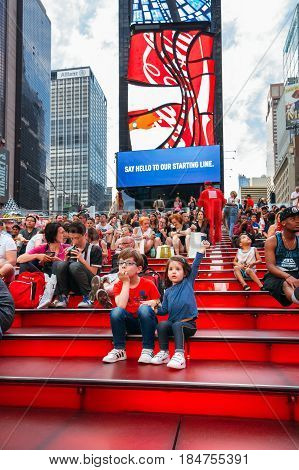 NEW YORK CITY -JUNE 21: Kids sitting over famous stairs of Times Square, iconic symbol of New York City and the United States of America, March 21, 2016 in Manhattan, New York City, USA.