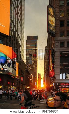 NEW YORK CITY -JUNE 21: People walking at sunset by 7th avenue and 43rd Street, on March 21, 2016 in Manhattan, New York City, USA.