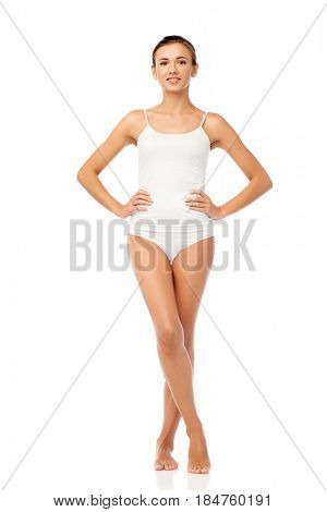 beauty, people and bodycare concept - beautiful young woman in white underwear