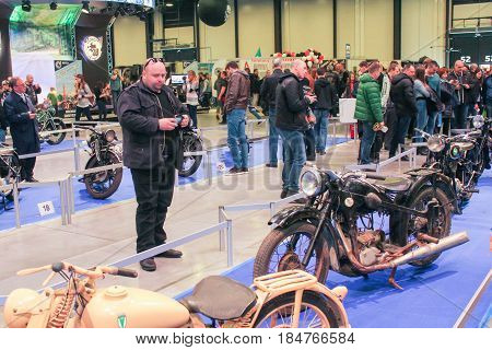 St. Petersburg Russia - 15 April, Visitors looking at retro models of motorcycles,15 April, 2017. International Motor Show IMIS-2017 in Expoforurum. Visitors and participants of the annual moto-salon in St. Petersburg.