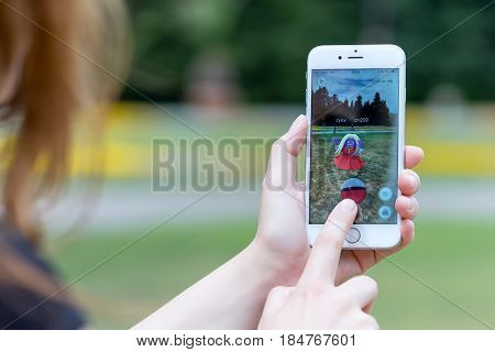 Varna Bulgaria - Jul 20 2016: Nintendo Pokemon Go augmented reality mobile application game with Jynx pokemon catching on Apple iPhone 6S in female hands.