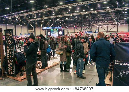 St. Petersburg Russia - 15 April, A large crowd of people at the motor depot,15 April, 2017. International Motor Show IMIS-2017 in Expoforurum. Visitors and participants of the annual moto-salon in St. Petersburg.