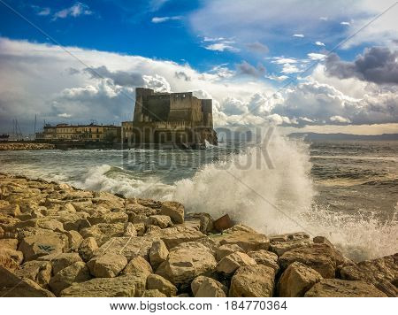 Storm Sea in Napoli, an old fortress. Italy