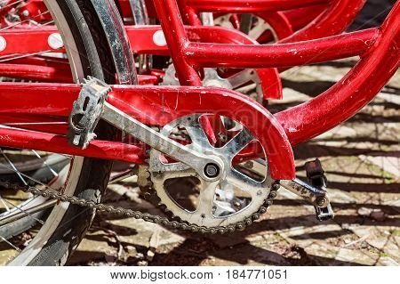 Closeup image of red bicycles parts with pedals and frame