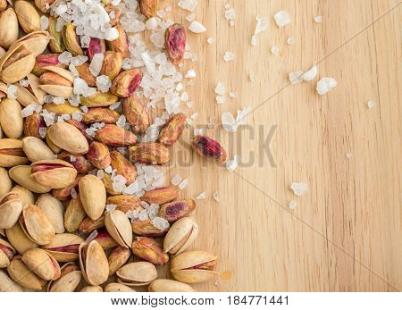 Heap Of Inshell Pistachios And Peeled Pistachios With Large Salt Crystals