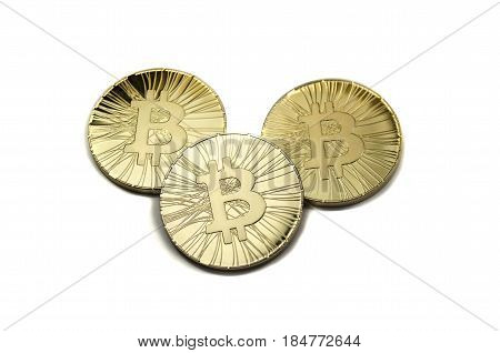 Three Shiny Bitcoin Coins On White Background