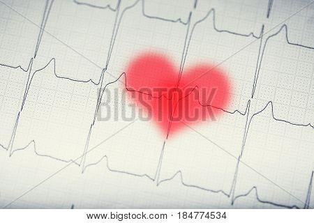 EKG graph.Electrocardiogram ekg ecg with red blurred heart.