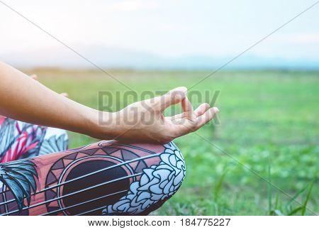 Closeup Hands For Young Woman Practicing Yoga(yoga Lotus Meditation).