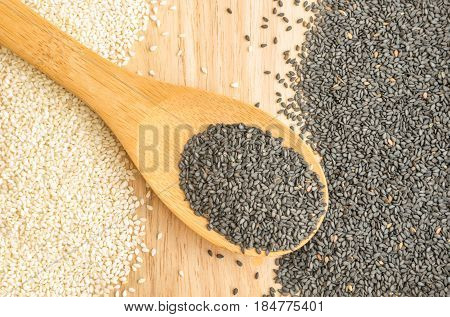 Black And White Sesame Seeds On Wooden Background