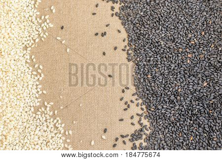 Black And White Sesame Seeds On Canvas Background With Space For Text