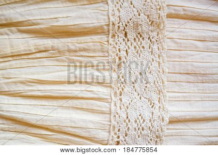 Closeup of whie linen cloth with insertion