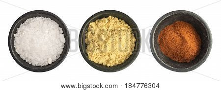 Group Of Ground Red Pepper, Salt And Mustard Powder Isolated
