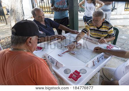 MIAMI,USA-APRIL 28,2017: The Cuban people of Miami playing dominoes in Little Havana. The Maximo Gomez Park a.k.a. Domino Park is a famous place whhich is a major tourist attraction in the city.