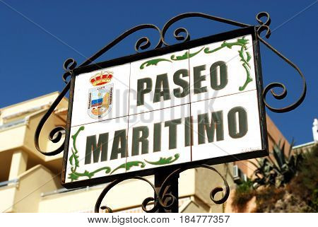 TORREMOLINOS, SPAIN - SEPTEMBER 3, 2008 - Ceramic Paseo Maritimo street sign in a wrought iron frame Torremolinos Malaga Province Andalusia Spain Western Europe, September 3, 2008.