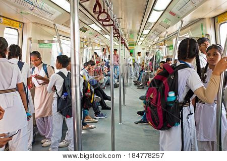 INDIA, NEW DEHLHI - APRIL 5, 2017: Indian people in the metro in New Dehli on the 5th of april 2017
