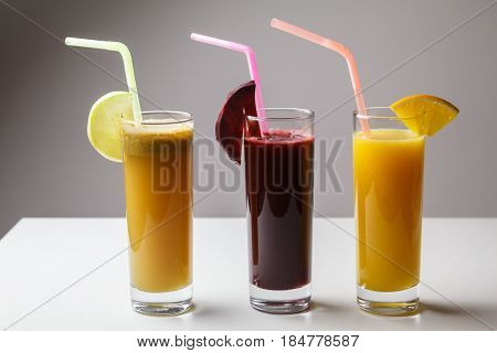 Healthy Eating Juicing Cleanse Diet Trend Concept - Fruit And Vegetable Juice Glasses With Straw. Th