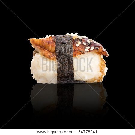 Nigiri Sushi With Smoked Eel And Seaweed Nori On Dark Background