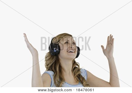 Cute Blond-haired Woman Enjoying While Listening To Music