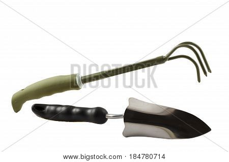 Small Hand Garden Rake And Trowel On White Isolated Background