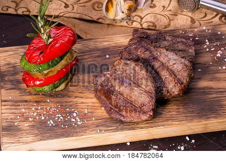 The juicy beef made on a grill with paprika, a vegetable marrow and an eggplant