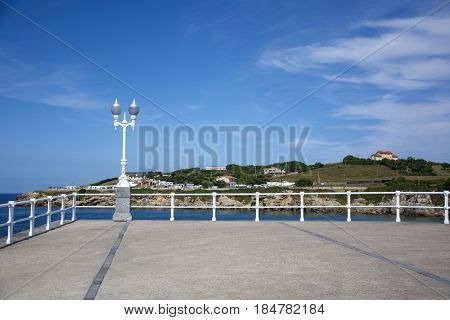 Photo of a streetlight with blue sky and sunlight