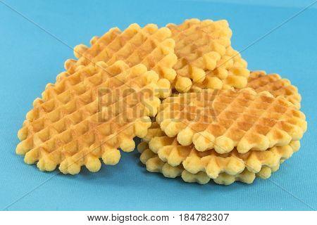 The crisp fresh waffles on blue background