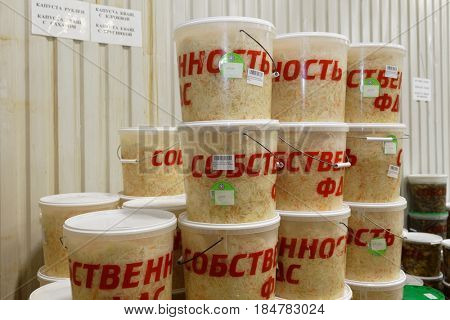 ST. PETERSBURG, RUSSIA - FEBRUARY 28, 2017: Containers with pickled cabbage in the Factory of Homemade Pickles It participates in the regional quality certification program St. Petersburg Quality Mark