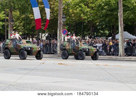 Paris France - July 14 2012. Procession of military equipment during the military parade on the Champs Elysees in Paris.
