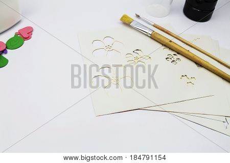 Art supplies consisiting of paint glue stencils foam stickers and paint brushes