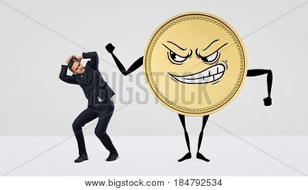 A giant humanoid coin with an angry face beating at a small businessman. Empty pockets. Credit and taxation. Foreign exchange.